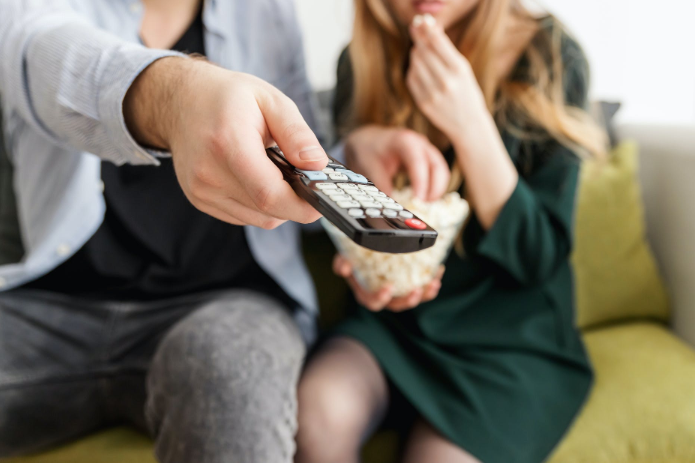 Why do people prefer watching movies at home?